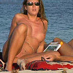 Girls on the beach - topless and fully nude. Big breasts and small tits